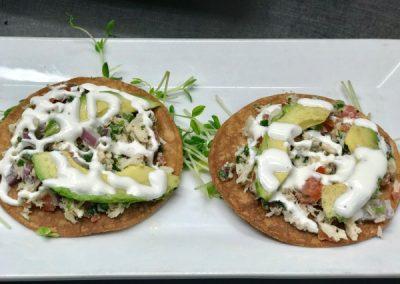 Fresh appetizers Crab and avocado tostadas